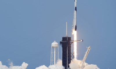 A SpaceX Falcon 9, with NASA astronauts Doug Hurley and Bob Behnken in the Dragon crew capsule, lifts off from Pad 39A at the Kennedy Space Center in Cape Canaveral, Fla., on Saturday. David J. Phillip/AP